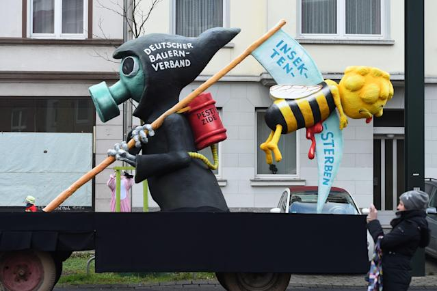 "<p>A carnival float, depicting a grim reaper killing a bee, is pictured during a carnival parade on Rose Monday on Feb. 12, 2018 in Duesseldorf, western Germany. The writings read ""German farmers association"" (L) and ""insects are dying"" (R). Germany. (Photo: Patrik Stollarz/Getty Images) </p>"