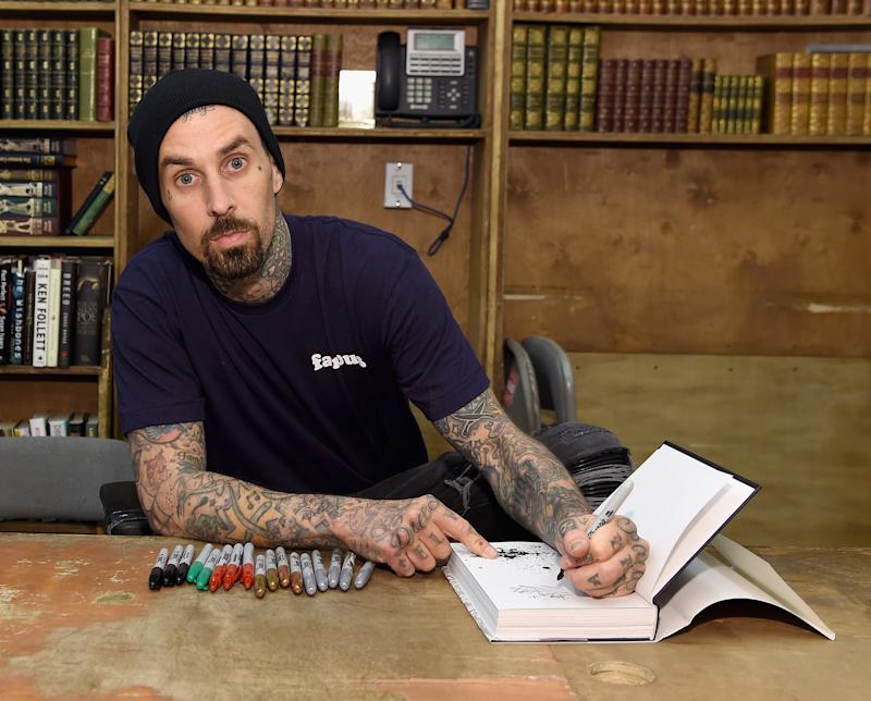 Travis Barker signs copies of 'Can I Say: Living Large, Cheating Death, and Drums, Drums, Drums.' (Photo: Getty Images)