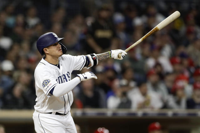 San Diego Padres' Manny Machado watches his grand slam hit during the sixth inning of a baseball game against the Philadelphia Phillies, Monday, June 3, 2019, in San Diego. (AP Photo/Gregory Bull)