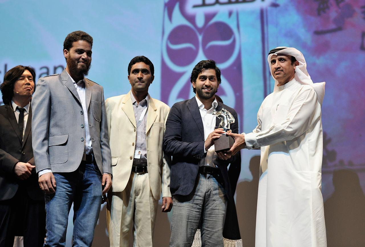 DUBAI, UNITED ARAB EMIRATES - DECEMBER 16:  Producer Musa Sayeed (second right) with Muhr AsiaAfrica Feature Special Jury Prize award during the Closing Ceremony on day eight of the 9th Annual Dubai International Film Festival held at the Madinat Jumeriah Complex on December 16, 2012 in Dubai, United Arab Emirates.  (Photo by Gareth Cattermole/Getty Images for DIFF)