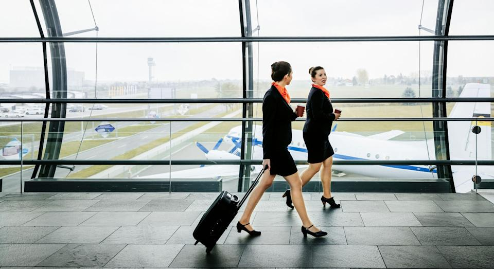 An airline's female flight attendants must have a doctor's note to not wear heels [Image: Getty]