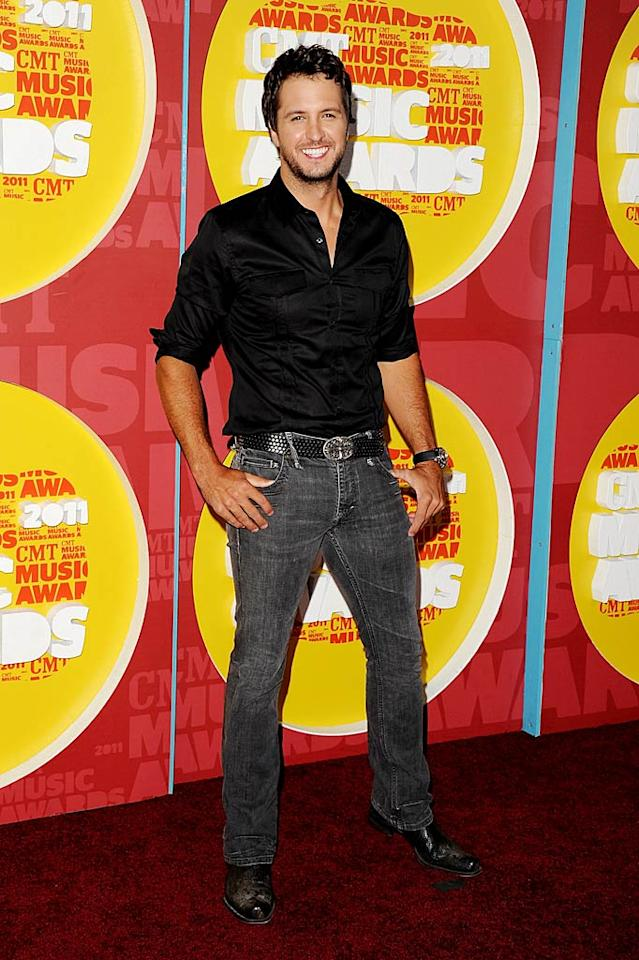 "Despite his acid wash-like black jeans, Luke Bryan still managed to light up the red carpet with his adorable smile! Jon Kopaloff/<a href=""http://filmmagic.com/"" target=""new"">FilmMagic.com</a> - June 8, 2011"