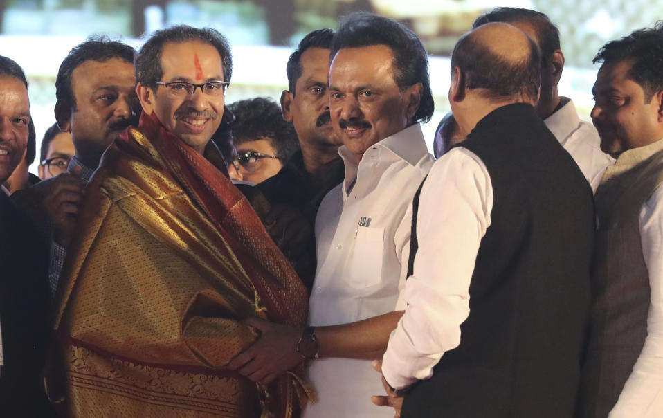 Shiv Sena party leader Uddhav Thackeray, left, is congratulated by M.K. Stalin of Dravida Munnetra Kazhagam (DMK) party after the former took oath as Maharashtra state chief minister during a swearing-in-ceremony in Mumbai, Thursday, Nov. 28, 2019. Supporters of the Shiv Sena, Nationalist Congress Party (NCP) and the Congress party thronged Shivaji Park to watch their leaders take oath of office. (AP Photo/Rafiq Maqbool)