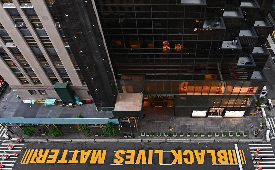 FILE PHOTO: A newly painted Black Lives Matter mural adorns Fifth Avenue outside of Trump Tower on July 10, 2020 in New York City. (Photo: ANGELA WEISS/AFP via Getty Images)
