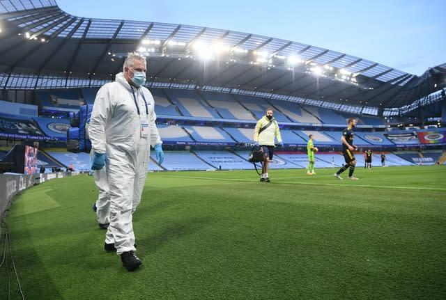 Medical staff have to wear PPE (Laurence Griffiths/NMC/PA)