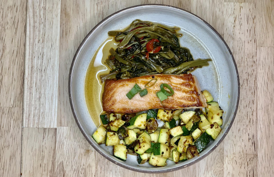 Ponzu salmon: This quick, day-of meal took just 15 minutes to prepare. I pan-seared salmon and topped it with store-bought soy sauce, sautéed water spinach with garlic, soy and chilis, and sautéed zucchini with shichimi togarashi. (Courtesy of the author)