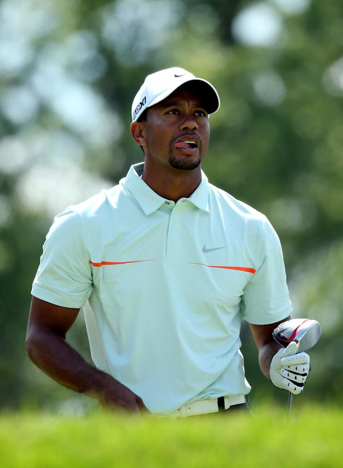 ARDMORE, PA - JUNE 15:  Tiger Woods of the United States looks on from the fourth tee during Round Three of the 113th U.S. Open at Merion Golf Club on June 15, 2013 in Ardmore, Pennsylvania.  (Photo by Andrew Redington/Getty Images)
