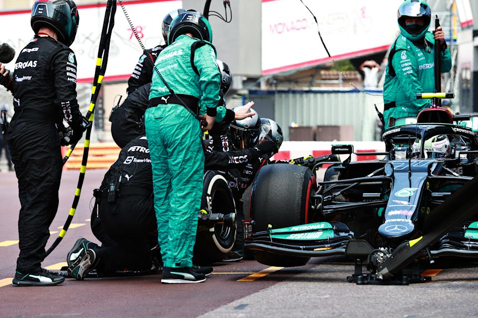 MONTE-CARLO, MONACO - MAY 23: Valtteri Bottas of Finland driving the (77) Mercedes AMG Petronas F1 Team Mercedes W12 makes a pitstop but his front right wheel is stuck on his car leading to his retirement from the race during the F1 Grand Prix of Monaco at Circuit de Monaco on May 23, 2021 in Monte-Carlo, Monaco. (Photo by Mark Thompson/Getty Images)