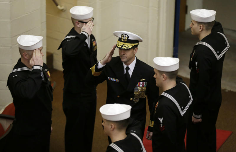 """Rear Admiral Ken Perry arrives at the decommissioning ceremony for the fire-damaged USS Miami nuclear submarine at the Portsmouth Naval Shipyard, Friday, March 28, 2014, in Kittery, Maine. Perry, commander of the submarine Group Two in Groton, Conn., where the sub was based, acknowledged the seriousness of the event, but told the crowd they were there to celebrate the submarine and its crew's achievements. """"This is a tribute. This is a celebration of the ship's performance and the superb contributions to the nation's defense and this is how we're going to treat it. So I expect to see some smiles out there,"""" he said. (AP Photo/Robert F. Bukaty)"""