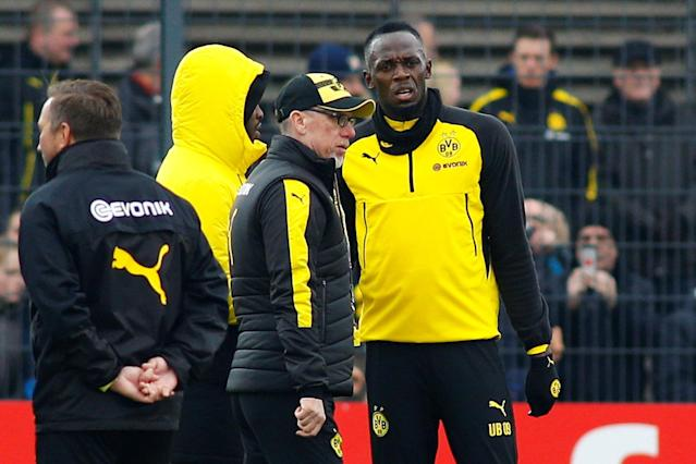Soccer Football - Usain Bolt participates in a training session with Borussia Dortmund - Strobelallee Training Centre, Dortmund, Germany - March 23, 2018 Borussia Dortmund coach Peter Stoeger and Usain Bolt during training REUTERS/Thilo Schmuelgen