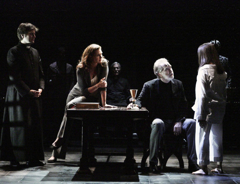 """This undated theater image released by the Geffen Playhouse shows, foreground from left, Manoel Felciano, Brooke Shields, Harry Groener and Emily Yetter in the world premiere of John Pielmeier's """"The Exorcist"""" at the Geffen Playhouse in Los Angeles. The play, an adaptation of the 1971 William Peter Blatty novel, runs through Aug. 12. (AP Photo/Geffen Playhouse, Michael Lamont)"""