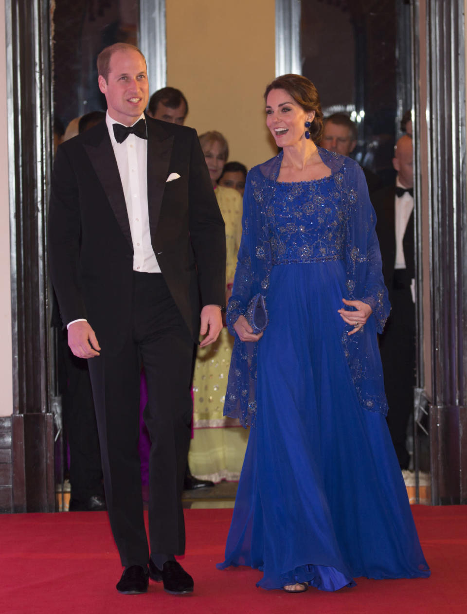 <p>Kate's gorgeous royal blue gown for the Bollywood Charity Gala was designed by her go-to party brand, Jenny Packham. The fabric was hand-beaded in India and was paired with a matching embellished cape and bag. </p><p><i>[Photo: PA]</i></p>