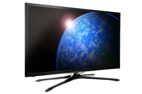 Flat-panel TV showing a planet and sun