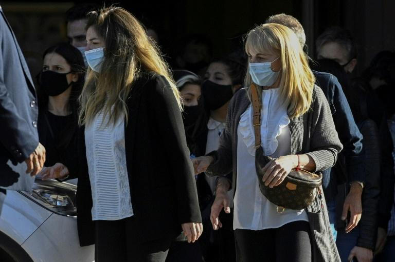 Diego Maradona's daughters Dalma (L) and his ex-wife Claudia Villafane at his funeral on Thursday, November 26, 2020 in Buenos Aires