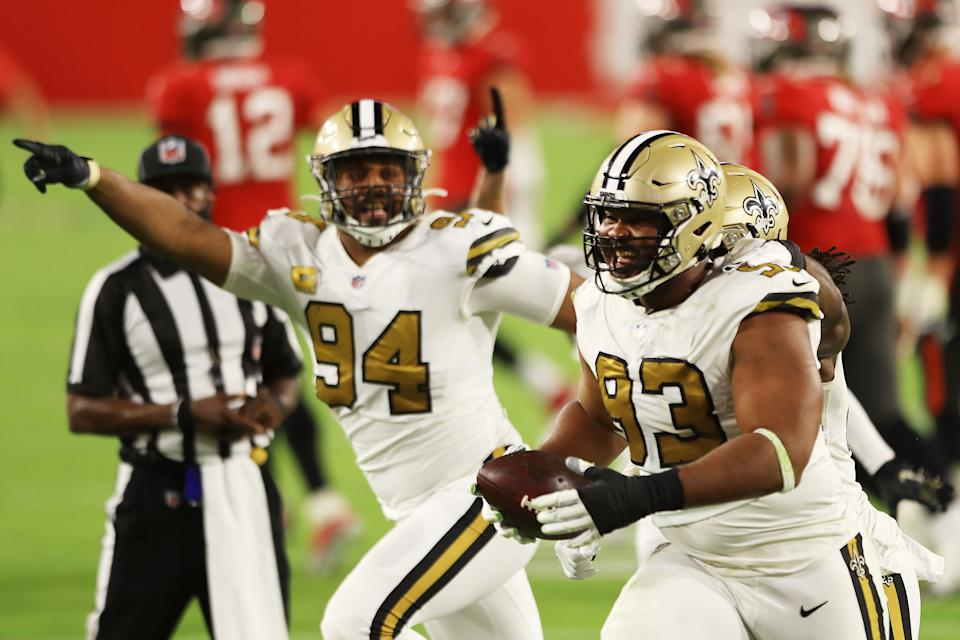 David Onyemata (93) of the New Orleans Saints celebrates with teammates after intercepting a pass during the second quarter against the Tampa Bay Buccaneers. (Photo by Mike Ehrmann/Getty Images)