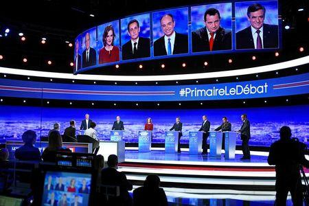 From L-R, French politicians Bruno Le Maire, Alain Juppe, Nathalie Kosciusko-Morizet, Nicolas Sarkozy, Jean-Francois Cope, Jean-Frederic Poisson and Francois Fillon attend the first prime-time televised debate for the French conservative presidential primary in La Plaine Saint-Denis, near Paris, France, October 13, 2016.    REUTERS/Martin Bureau/Pool