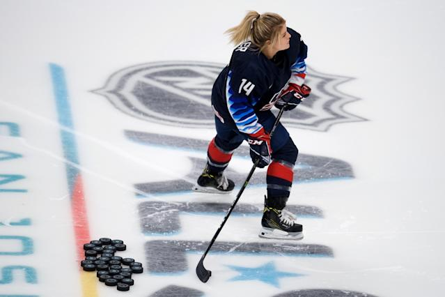 U.S. national team member Brianna Decker will be paid $25,000 after winning the premier passing drill at the NHL All-Star skills event on Friday after initially being told her run didn't count. (Matt Cohen/Getty Images)