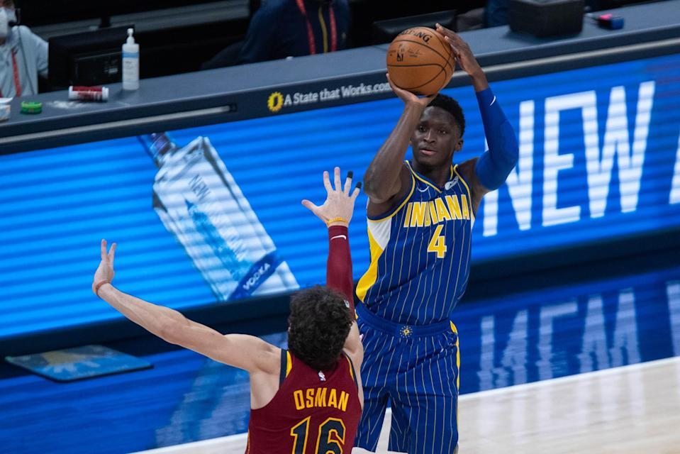 Dec 31, 2020; Indianapolis, Indiana, USA; Indiana Pacers guard Victor Oladipo (4) shoots the ball over Cleveland Cavaliers forward Cedi Osman (16) in the second quarter at Bankers Life Fieldhouse.