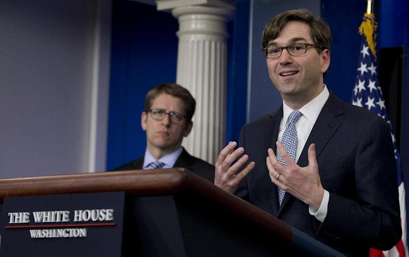Chairman of the Council of Economic Advisers Jason Furman, right, accompanied by White House press secretary Jay Carney, speaks during the daily news briefing at the White House in Washington, Tuesday, Feb. 4, 2014, about the Congressional Budget Office (CBO) report and the Affordable Care Act. The federal deficit is likely to continue its slide to a lower-than-expected $514 billion for 2014, the nonpartisan CBO reported Tuesday, Feb. 4, 2014. (AP Photo/Carolyn Kaster)
