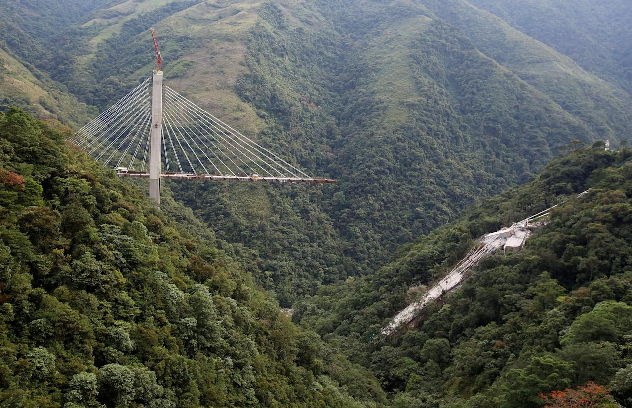 <p>A bridge under construction that collapsed leaving dead and injured workers in Chirajara near Bogota, Colombia, in January. (REUTERS/Jaime Saldarriaga) </p>