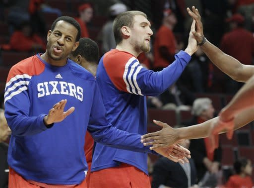 Philadelphia 76ers forward Andre Iguodala, left, and center Spencer Hawes celebrate with teammates after the 76ers defeated the Chicago Bulls 109-92 in Game 2 in an NBA basketball first-round playoff series, in Chicago on Tuesday, May 1, 2012. (AP Photo/Nam Y. Huh)
