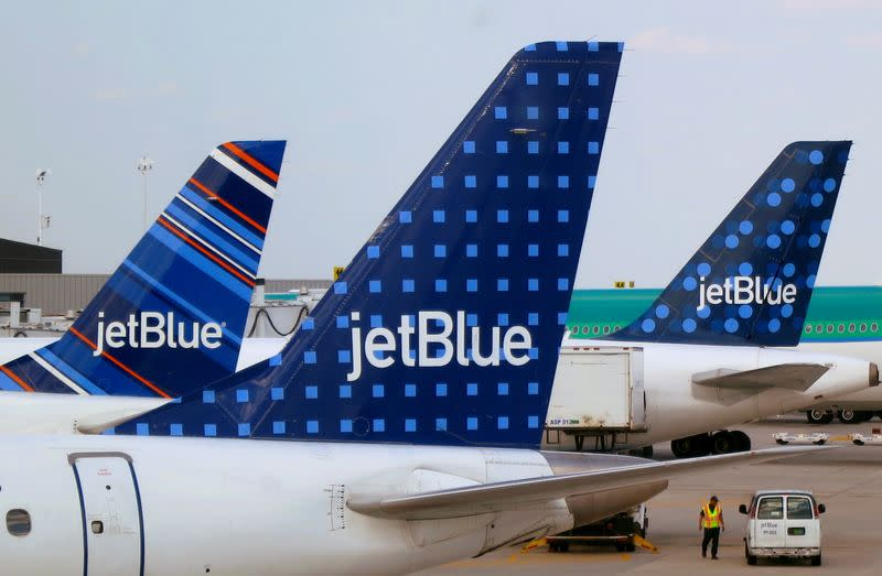 FILE PHOTO: JetBlue Airways aircraft are pictured at departure gates at John F. Kennedy International Airport in New York