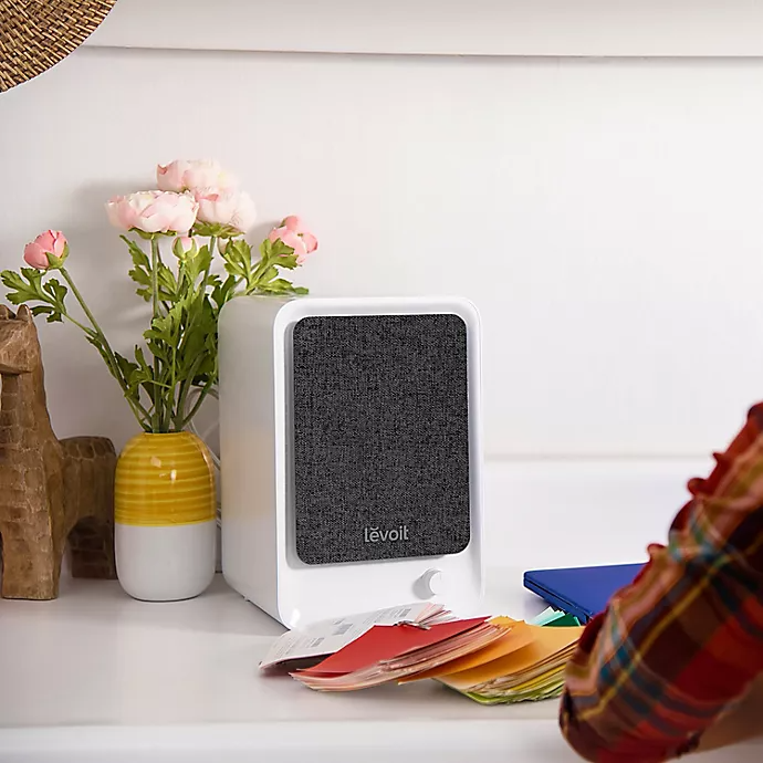 """<strong><h3>Levoit Desktop True HEPA Air Purifier</h3></strong><br>Is this air purifier...cute? Well, it's certainly not imposing which is why it makes a great addition to your home office or bedroom or bedroom-home-office. Over 700 Amazon reviewers gave this super air cleaner a 5-star review.<br><br><em>Shop <a href=""""https://www.bedbathandbeyond.com/store/brand/levoit/7569/"""" rel=""""nofollow noopener"""" target=""""_blank"""" data-ylk=""""slk:Levoit"""" class=""""link rapid-noclick-resp"""">Levoit</a></em><br><br><strong>Levoit</strong> Desktop True HEPA Air Purifier, $, available at <a href=""""https://go.skimresources.com/?id=30283X879131&url=https%3A%2F%2Fwww.bedbathandbeyond.com%2Fstore%2Fproduct%2Flevoit-desktop-true-hepa-air-purifier%2F5550545"""" rel=""""nofollow noopener"""" target=""""_blank"""" data-ylk=""""slk:Bed Bath & Beyond"""" class=""""link rapid-noclick-resp"""">Bed Bath & Beyond</a>"""