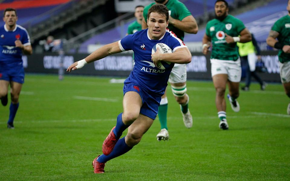 France's Antoine Dupont runs in to score his sides first try during the 6 Nations match - PA