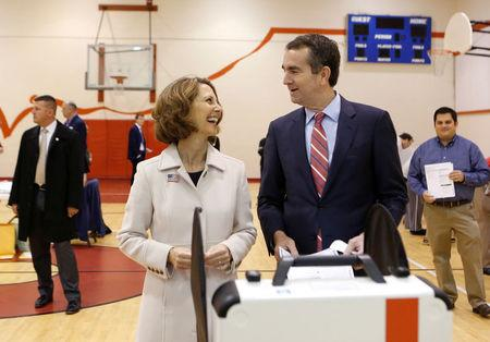 Virginia Lieutenant Governor Ralph Northam, who is campaigning to be elected as the state's governor, and his wife Pam, cast their ballots at the East Ocean View Community Center in Norfolk, Virginia, U.S. November 7, 2017. REUTERS/Julia Rendleman
