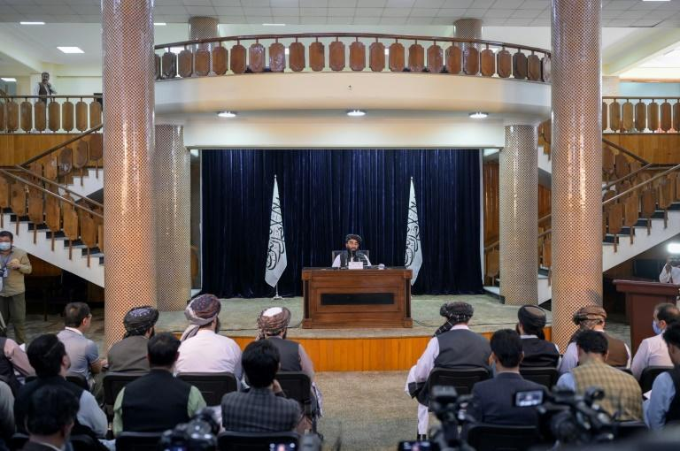 Zabihullah Mujahid, chief spokesman for the Taliban, announces the group's new appointment during a Kabul press conference (AFP/BULENT KILIC)