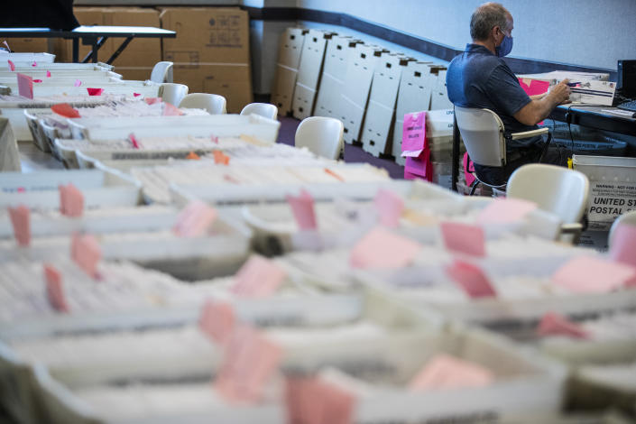 Dave Turnier processes mail-in ballots at at the Chester County Voter Services office in West Chester, Pa., prior to the primary election on May 28, 2020. (Matt Rourke/AP)