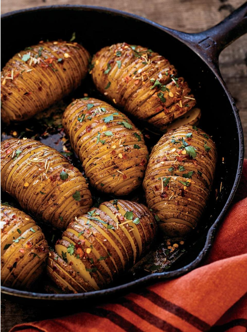 """<p>These perfectly spiced, heavily buttered, evenly cut potatoes are elegant, delicious, and easy to make. What more could you want? </p><p><strong><a href=""""https://www.countryliving.com/food-drinks/a34277029/cast-iron-hasselback-potatoes/"""" rel=""""nofollow noopener"""" target=""""_blank"""" data-ylk=""""slk:Get the recipe"""" class=""""link rapid-noclick-resp"""">Get the recipe</a>.</strong> </p>"""