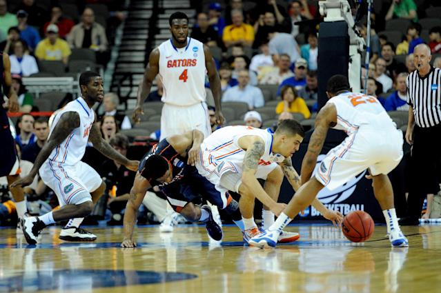 OMAHA, NE - MARCH 16: Scottie Wilbekin #5 (C) and Bradley Beal #23 of the Florida Gators fight for a loose ball against Jontel Evans #1 of the Virginia Cavaliers during the second round of the 2012 NCAA Men's Basketball Tournament at CenturyLink Center on March 16, 2012 in Omaha, Nebraska. (Photo by Eric Francis/Getty Images)