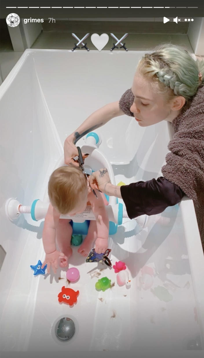 Grimes shared a photo of herself cutting her son's hair in her Instagram Story. (Courtesy Grimes/Instagram)