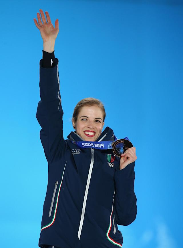 SOCHI, RUSSIA - FEBRUARY 21: Bronze medalist Carolina Kostner of Italy celebrates during the medal ceremony for the Women's Free Figure Skating on day fourteen of the Sochi 2014 Winter Olympics at Medals Plaza on February 21, 2014 in Sochi, Russia. (Photo by Streeter Lecka/Getty Images)