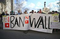 <p>People hold up a banner at a rally in New York's Battery Park in New York, Jan. 29, 2017, protesting President Donald Trump's immigration order. (Gordon Donovan/Yahoo News) </p>