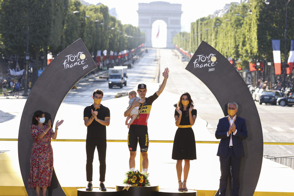 Stage winner Belgium's Wout Van Aert celebrates on the podium after the twenty-first and last stage of the Tour de France cycling race over 108.4 kilometers (67.4 miles) with start in Chatou and finish on the Champs Elysees in Paris, France,Sunday, July 18, 2021. (Garnier Etienne/L'Equipe via AP, Pool)