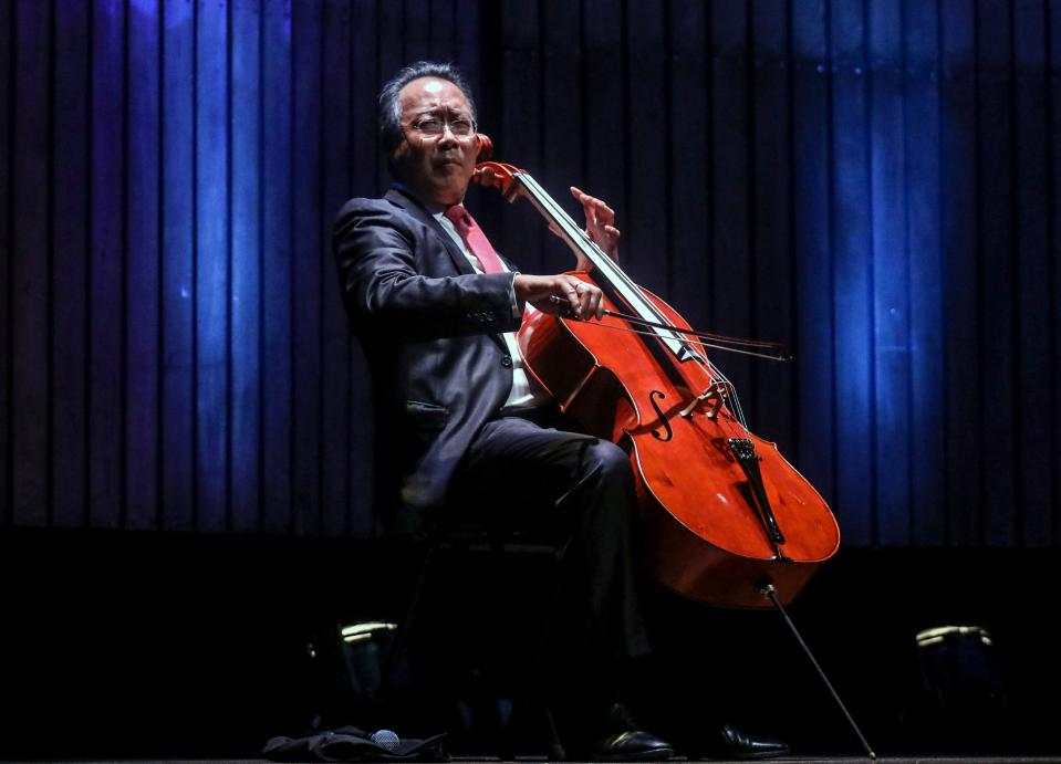 French-born Chinese-American cellist Yo-Yo Ma plays during a concert at the Metropolitan Theater in Medellin, Antioquia department, Colombia on May 9, 2019. (Photo by JOAQUIN SARMIENTO / AFP)        (Photo credit should read JOAQUIN SARMIENTO/AFP via Getty Images)