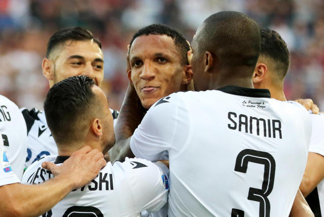 Udinese's Rodrigo Becao, center, celebrates after scoring his team's first goal during the Italian Serie A soccer match between Udinese and AC Milan at the Friuli stadium in Udine, Italy, Sunday, Aug. 25, 2019. (Gabriele Menis/ANSA via AP)