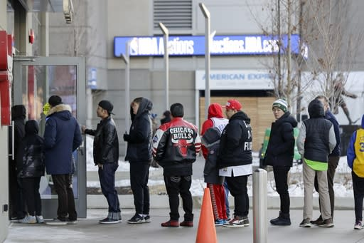 Fans line up to get into the United Center for the NBA All-Star basketball game Sunday, Feb. 16, 2020, in Chicago. (AP Photo/Nam Huh)