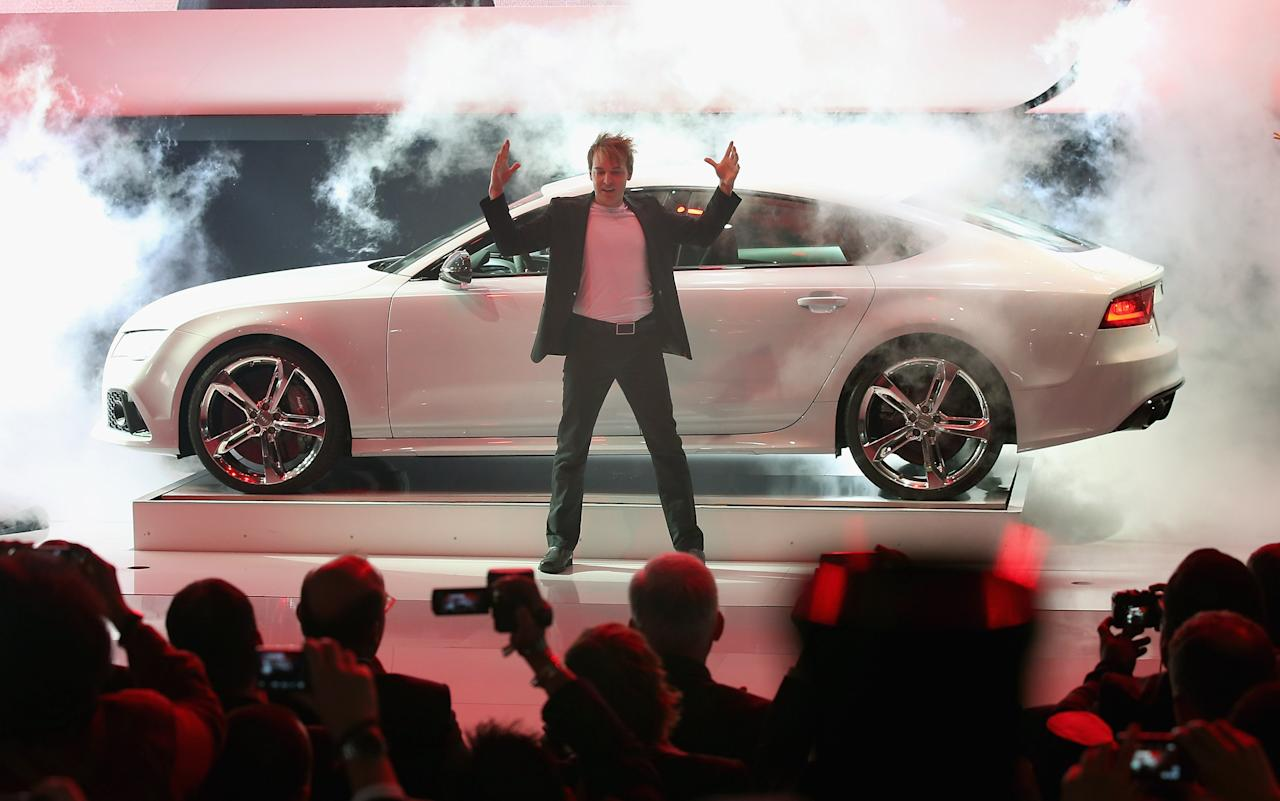 An illusionist performs during the reveal of the Audi RS7