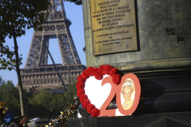<p>Photographs and flowers are placed by people in memory of the late Princess Diana above the Pont de l'Alma tunnel in Paris, Aug. 31, 2017. (Photo: Thibault Camus/AP) </p>