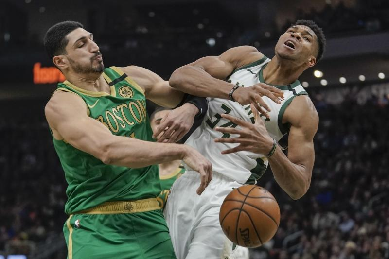 Boston Celtics' Enes Kanter fouls Milwaukee Bucks' Giannis Antetokounmpo during the first half of an NBA basketball game Thursday, Jan. 16, 2020, in Milwaukee. (AP Photo/Morry Gash)