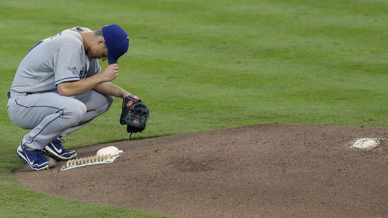Los Angeles Dodgers starting pitcher Zack Greinke rests after Atlanta Braves'Andrelton Simmons doubled in the second inning of Game 2 of the National League division series on Friday, Oct. 4, 2013, in Atlanta. (AP Photo/Mike Zarrilli)