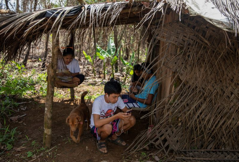 The Wider Image: Mountain trekking to catch a signal - meet the Philippine students determined to study as school gates stay locked