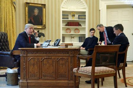 FILE PHOTO: U.S. President Donald Trump, joined by senior advisor Jared Kushner (3rd R), Communications Director Sean Spicer (2nd R) and National Security Advisor Michael Flynn (R), speaks by phone with  Saudi Arabia's King Salman in the Oval Office at the White House in Washington, U.S. January 29, 2017. REUTERS/Jonathan Ernst/File Photo