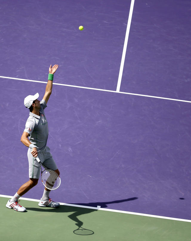 Novak Djokovic, of Serbia, serves to Rafael Nadal, of Spain, during the men's final match at the Sony Open Tennis tournament on Sunday, March 30, 2014, in Key Biscayne, Fla. (AP Photo/Lynne Sladky)