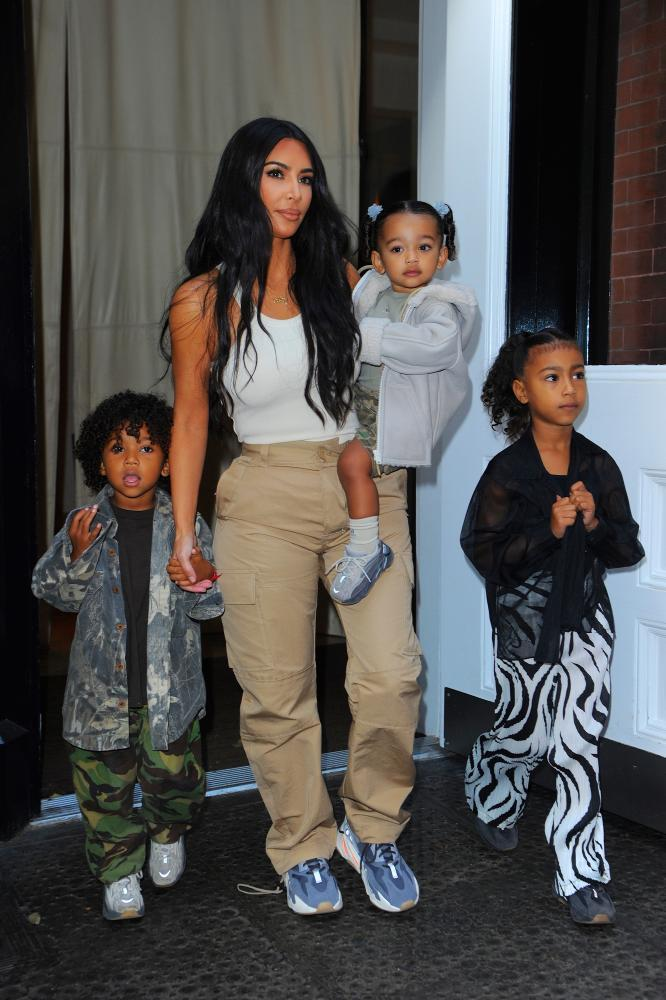 A mundanely familiar existence, performed for a global audience ... Kardashian West with her children.