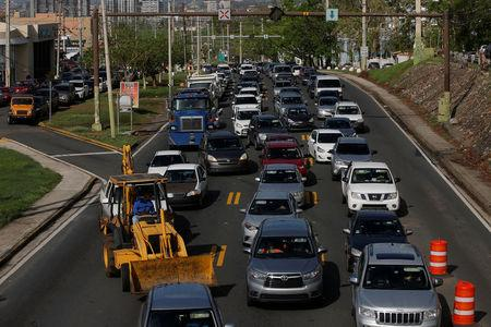 Traffic is seen along Puerto Rico Highway 2 caused by a construction site at a sinkhole caused by Hurricane Maria outside San Juan, Puerto Rico, October 12, 2017.  REUTERS/Shannon Stapleton