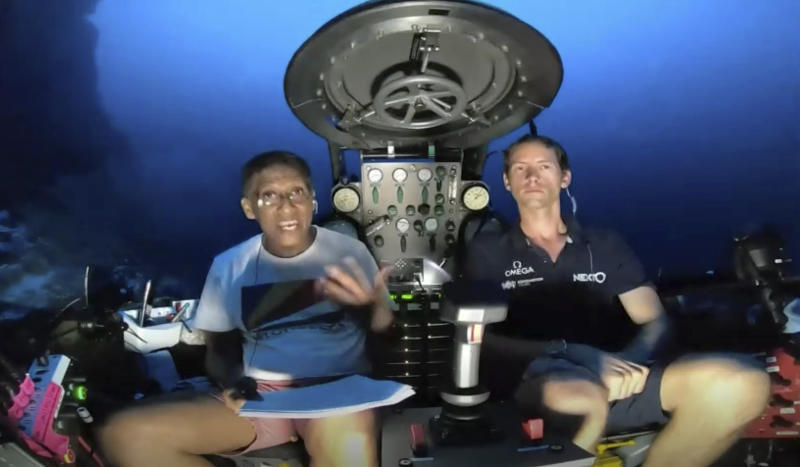 Seychelles President Danny Faure, left, delivered a deep-sea plea on Sunday, beseeching the world to do more to protect the world's oceans,